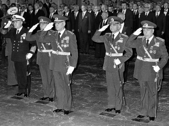 FILE – In this Oct. 29, 1980 file photo, the leaders of Sept. 12 military coup, from left to right, Adm. Nejat Tumer, Gen. Nurettin Ersin, Gen. Kenan Evren, Gen. Tahsin Sahinkaya and Gen. Sedat Celasun stand during a ceremony at the mausoleum of the founder of modern Turkey, Kemal Ataturk, in Ankara, Turkey. A Turkish court in Ankara on Wednesday, June 18, 2014 has sentenced the two surviving leaders of the country's 1980 military coup to life in prison. The court found 97-year-old Kenan Evren and 89-year-old Tahsin Sahinkaya guilty of crimes against the state.(AP Photo/Burhan Ozbilici, File)