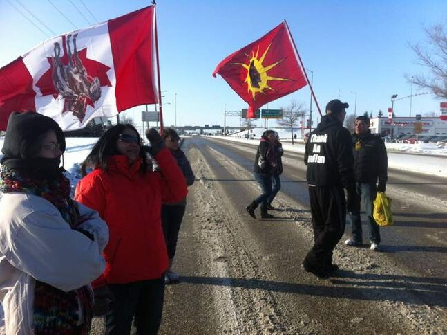 Protesters take part in an Idle No More rally at the intersection of Portage Avenue and St. Charles Street Wednesday