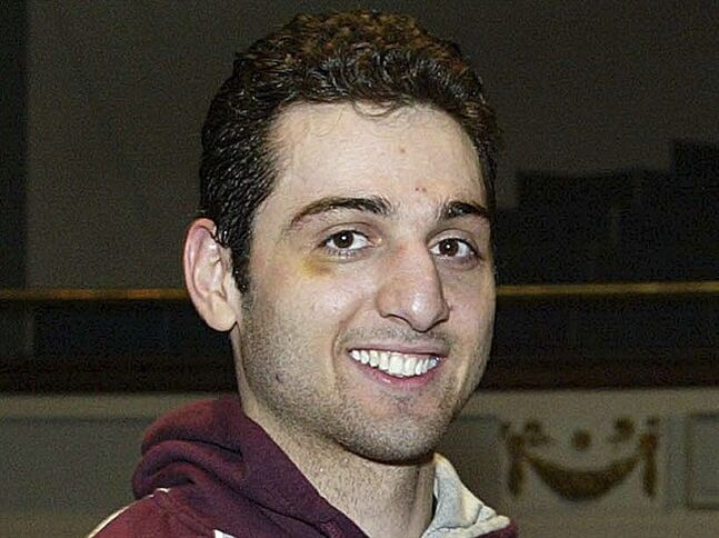 FILE - In this Feb. 17, 2010, photo, Tamerlan Tsarnaev smiles after accepting the trophy for winning the 2010 New England Golden Gloves Championship in Lowell, Mass. Tsarnaev is the Boston Marathon bombing suspect who was killed in a police shootout. Peter Stefan, the owner of a Worcester funeral home, said he still feels disturbed by the reaction he got when he agreed to take the remains of Tamerlan Tsarnaev last year after a funeral home in North Attleborough, where the body was initially sent, was picketed by protesters. Stefan is writing a book about his experience. (AP Photo/The Lowell Sun, Julia Malakie, File) MANDATORY CREDIT