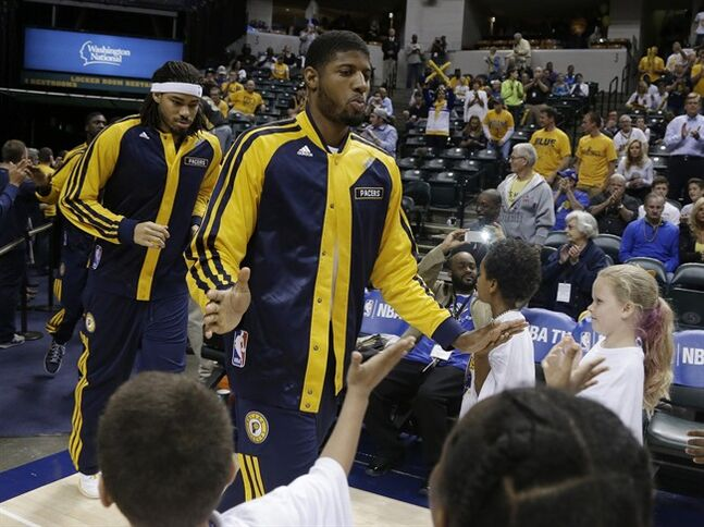 Indiana Pacers' Paul George runs onto the court for warm-ups at Game 5 of the Pacers' opening-round NBA basketball playoff series against the Atlanta Hawks, Monday, April 28, 2014, in Indianapolis. (AP Photo/Darron Cummings)