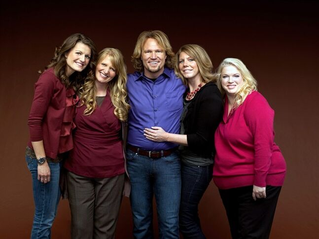 FILE - In this file publicity photo provided by TLC, Kody Brown, center, poses with his wives, from left, Robyn, Christine, Meri and Janelle, in a promotional photo for the reality series,