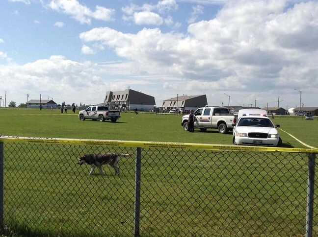Police tape surrounds the baseball diamond in Norway House where Evan Cromarty was shot by an RCMP officer.