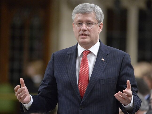 Prime Minister Stephen Harper responds to question during question period in the House of Commons on Parliament Hill in Ottawa on April 30, 2014. Ottawa says it is imposing economic sanctions on 16 more Russian