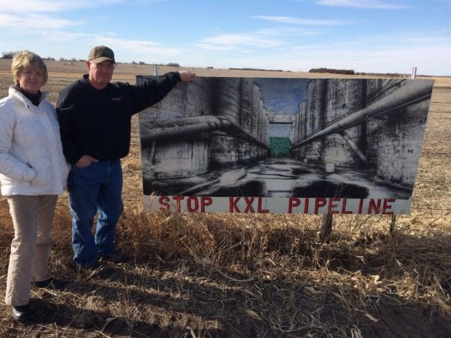 Ron and Jeanne Crumly, seen on their property in Page, Neb., say they have no intention of signing to allow the Keystone XL pipeline on their land - whatever they're offered. THE CANADIAN PRESS/Alex Panetta