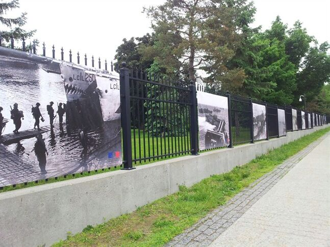 Two photo banners, second and third from the left,, from an exhibition paying tribute to the Canadian soldiers who took part in the 1944 Normandy landings have been stolen from in front of the French Embassy in Ottawa. Embassy spokesman Stephane Schorderet says the banners were taken Tuesday afternoon by two young men and a young woman who drove up in a black pickup truck. THE CANADIAN PRESS/HO-Ambassade de France au Canada