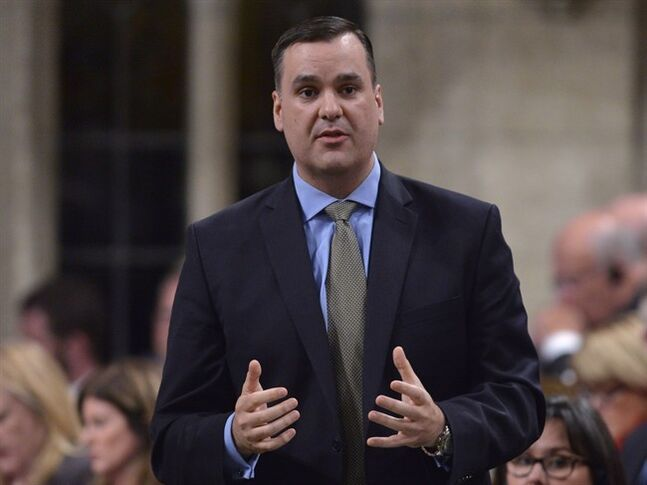 Minister of Industry James Moore responds to a question during Question Period in the House of Commons Tuesday June 17, 2014 in Ottawa. Moore says he's on a mission to create a true free trade zone within Canada and expects to hand officials a mandate to start the process of negotiating with provinces as early as this fall. THE CANADIAN PRESS/Adrian Wyld