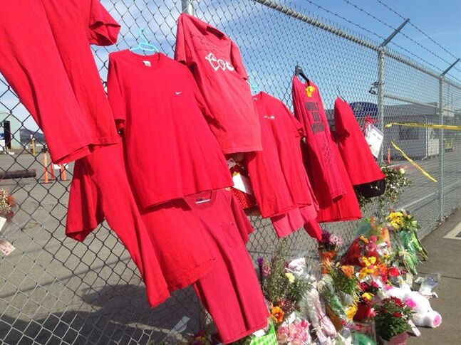 Shirts hang in memory of dead workers at the Nanaimo mill site on Thursday May 1, 2014. THE CANADIAN PRESS/Dirk Meissner