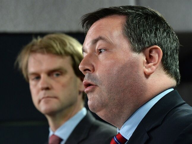 Employment Minister Jason Kenney speaks at a news conference in Ottawa on Friday, June 20, 2014 on reforms to the Temporary Foreign Worker Program. Citizenship and Immigration Minister Chris Alexander is seen in background.THE CANADIAN PRESS/Sean Kilpatrick
