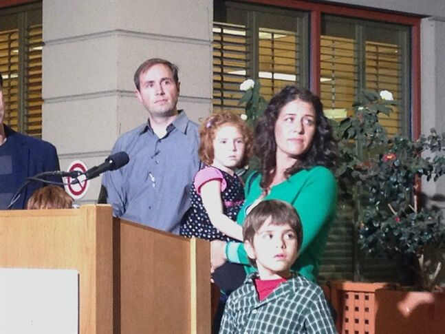 In this photo taken with a mobile phone, Jessica Tomei holds her 4-year-old daughter, Sofia Jarvis, during a news conference at Lucille Packard Children's Hospital at Stanford University on Monday, Feb. 24, 2014, in Palo Alto, Calif. Sofia is one of a handful of California children who has been diagnosed with a rare polio-like syndrome that has left her arm paralyzed. Stanford researchers say there is a possibility of an emerging infectious polio-like syndrome in California. (AP Photo/Martha Mendoza)