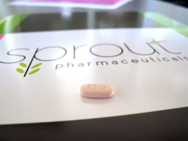 FILE - In this Friday, Sept. 27, 2013, file photo, a tablet of flibanserin sits on a brochure for Sprout Pharmaceuticals in the company's Raleigh, N.C., headquarters. Sprout Pharmaceuticals said Tuesday, Feb. 11, 2014, that the Food and Drug Administration wants to see more data on how the company's drug, flibanserin, interacts with other medications and how it affects driving ability. Nearly 10 percent of women studied in company trials reported sleepiness while taking the daily pill. (AP Photo/Allen G. Breed)