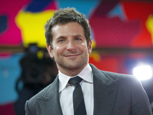 FILE - This Feb. 7, 2014 file photo shows actor Bradley Cooper arrives on the red carpet for the screening of the film American Hustle during the International Film Festival Berlinale, in Berlin. Cooper will be one of many Hollywood stars who will present awards at the Tony Awards on June 8. (AP Photo/Axel Schmidt, File)