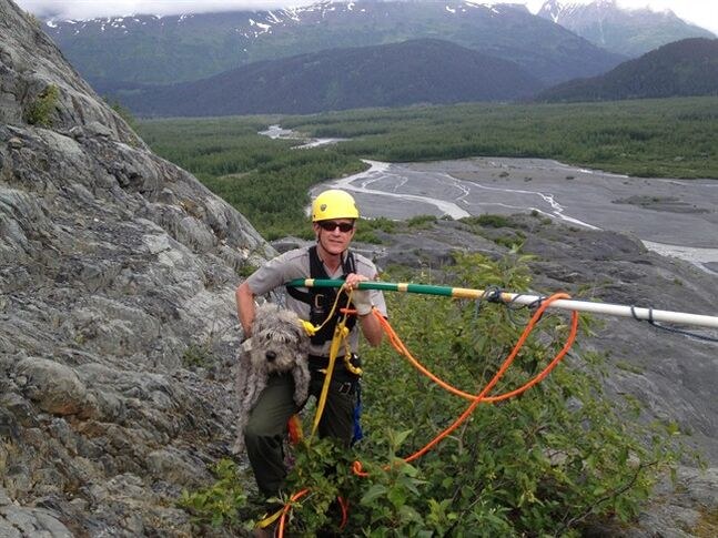 Kenai Fjords National Park Ranger John Anderson is shown with Sadie after her rescue from a ledge near a glacier on Monday, June 30, 2014, at Kenai Fjords National Park, Alaska. (AP Photo/National Park Service, Mark Thompson)
