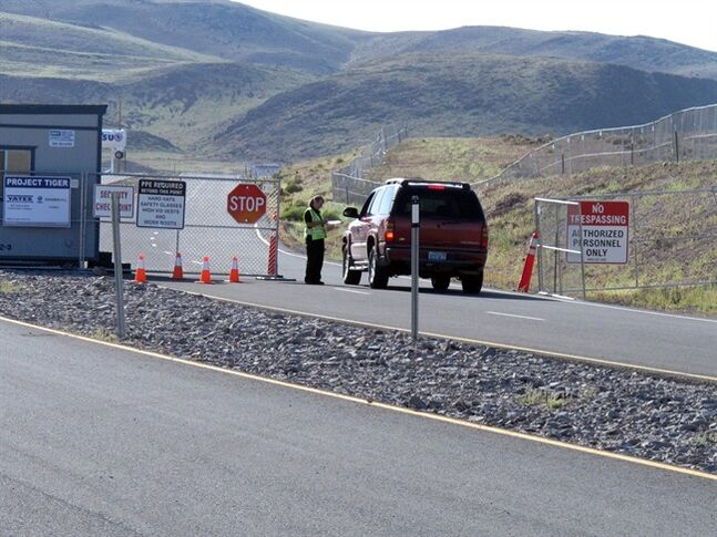 A guard stops a vehicle at the security checkpoint to enter the site at the Tahoe Reno Industrial Center 15 miles east of Sparks, Nev., Thursday, Sept. 4, 2014. Tesla Motors Inc. plans to build a 6,500 worker