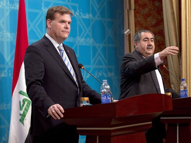 Canadian Foreign Affairs Minister John Baird (left) and Iraqi Foreign Affairs Minister Hoshyar Zebari hold a joint news conference, Wednesday, September 3, 2014 in Baghdad, Iraq.THE CANADIAN PRESS/Ryan Remiorz