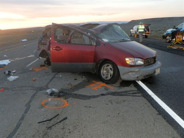 This image provided by the Utah Highway Patrol shows the scene of a car crash where authorities say four people died and four were injured in a van rollover crash Friday, May 16, 2014 on Interstate 70, about 30 miles west of the Colorado border. Police are investigating whether the van was involved in human smuggling. They are searching for one person who was in the van, but ran off after the crash. (AP Photo/Utah Highway Patrol)