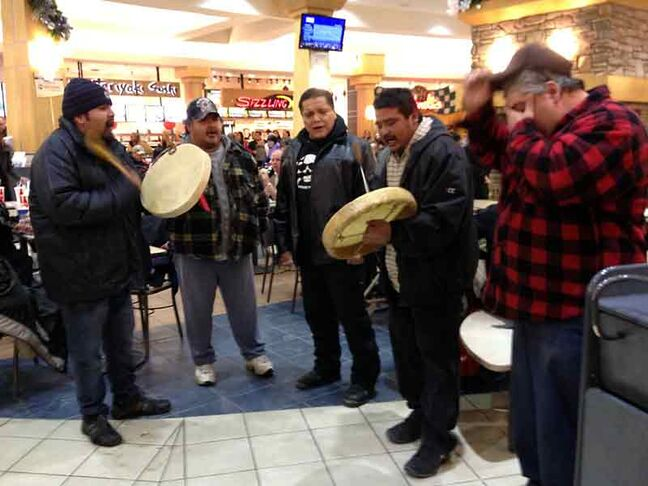 A group of aboriginal men chant and drum in the middle of the Shoppers Mall food court on Friday evening during an event that coincided with Idle No More protests across Canada.