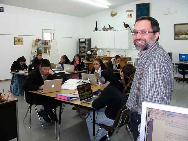 Teacher Mark Waldner and his students are shown in a Hutterite classroom on Decker Hutterite Colony.