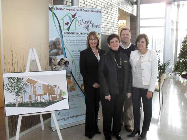 A Sense of Home campaign team (left to right) Karen Chrest, Gerry Walker, Kerry Auriat and Laurie Murray pose for a photo, marking the end of the capital campaign for the Murray House cancer treatment residence in December.