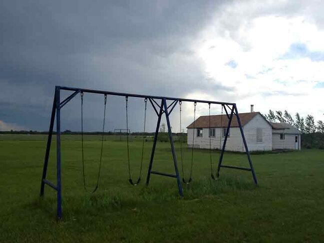 A swing set stands empty outside the one-room schoolhouse at a Manitoba Old Order Mennonite community. Child and Family Services apprehended the community's children due to allegations of physical abuse related to discipline.