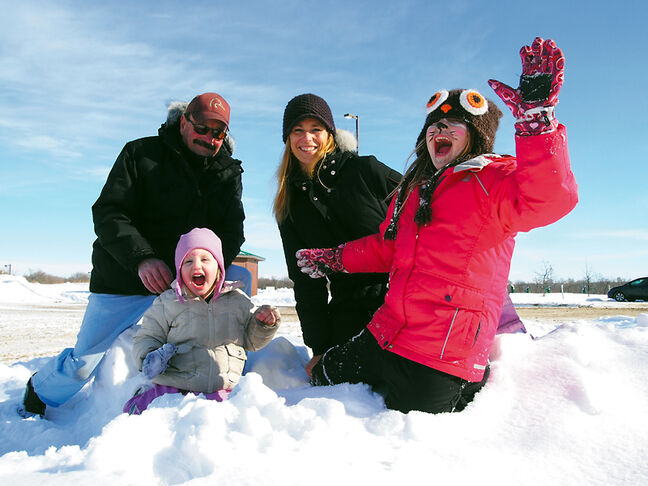 Dawn Oberlander and her daughters, Marin and Kael, of Winnipeg and Dawn's father, Arvid Lepard of Brandon, have some fun in the snow celebrating Louis Riel Day and Family Day at the Riverbank Discovery Centre on Monday.