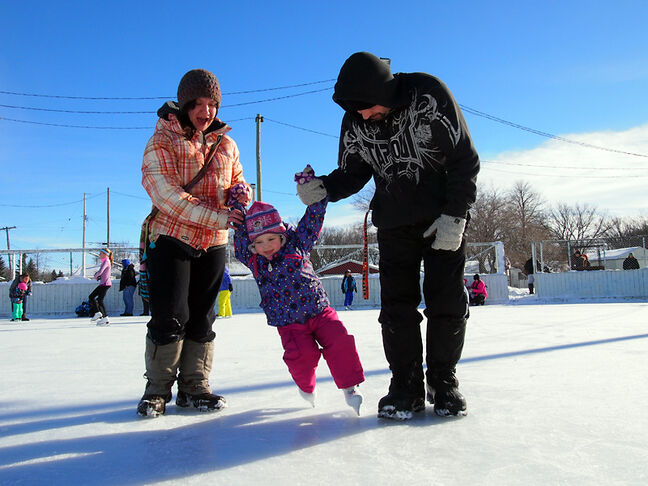 Chet and Lindsay Hetherington give their daughter Macy, 4, a skating lesson at the Valleyview Community Centre on Monday afternoon. It should be just as nice today.