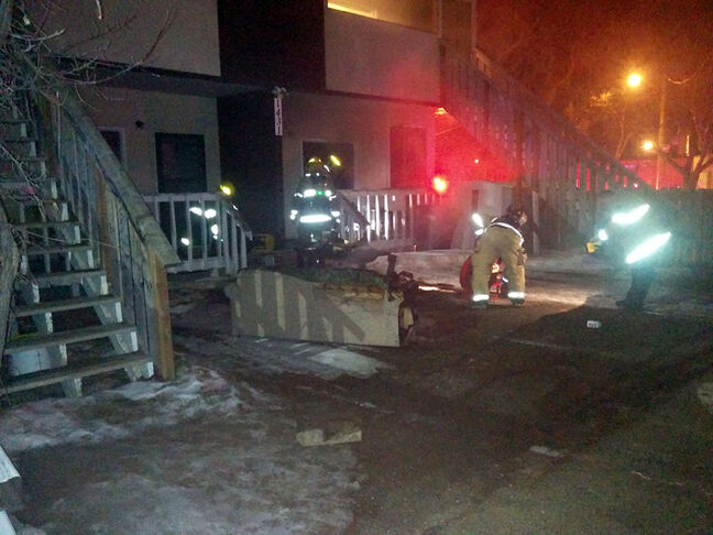 Local firefighters haul out furniture following an apartment fire at the corner of Princess Avenue and 15th Street around 11 p.m. on Saturday.