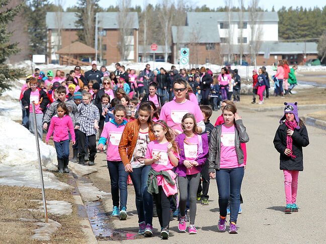 Students from O'Kelly School march past the CFB Shilo headquarters as part of the Red Cross Day of Pink against bullying on Wednesday. More than 240 students participated in the march organized by the school's Youth Revolution and leadership team.