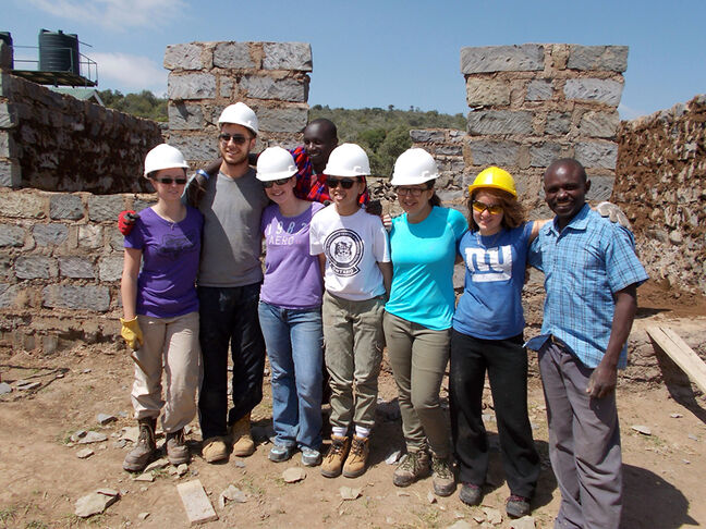 Gillis (third from left) and other Canadian students pose in front of the school they were building during their two-week international development stint in Kenya.