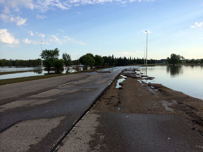 As the Assiniboine River recedes, it reveals damage has been done to First Street, where portions of the shoulder asphalt have been washed away, as seen on Monday.