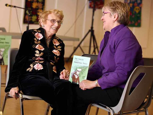 "Audrey Hanlon, left, and author Deana Driver chat prior to a book reading at Central United Church on Monday evening. Driver penned ""The Sailor and the Christmas Trees,"" a children's book detailing a remarkable true story from the Second World War involving Hanlon's husband, John."