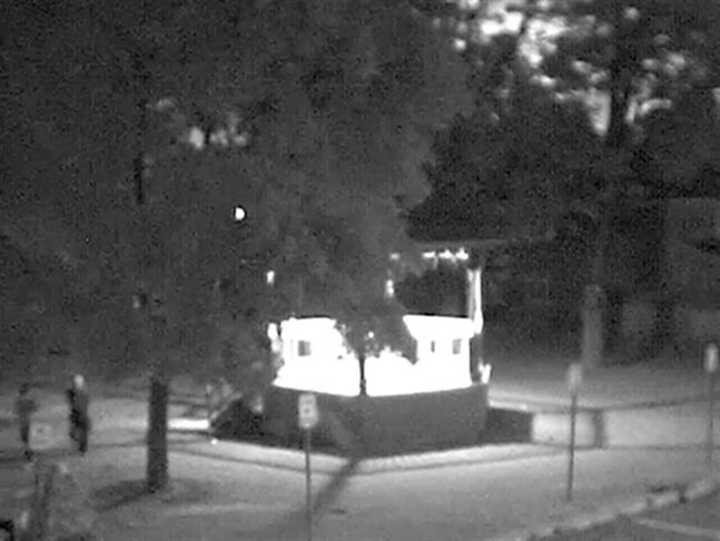 In this photo taken from a video, two people walk away from a gazebo in a park behind the Orangeville, Ont. town hall at about 5:58 am on August 30, 2010. Sonia Varaschin of Orangeville, Ont., was reported missing on Aug. 30, 2010, after she failed to show up at work. Her body was found days later in a wooded area in nearby Caledon. THE CANADIAN PRESS/ HO, OPP