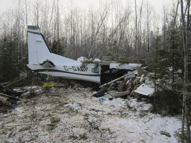 A report has found a plane was overloaded and its wings covered with ice before it crashed in November 2012.