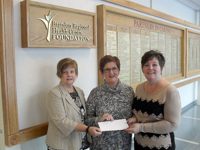 2013 Gala co-chairs Brenda Burgess (left) and Marci Crisanti (right) present a cheque to Gerry Walker, chair of the BRHC Foundation board.