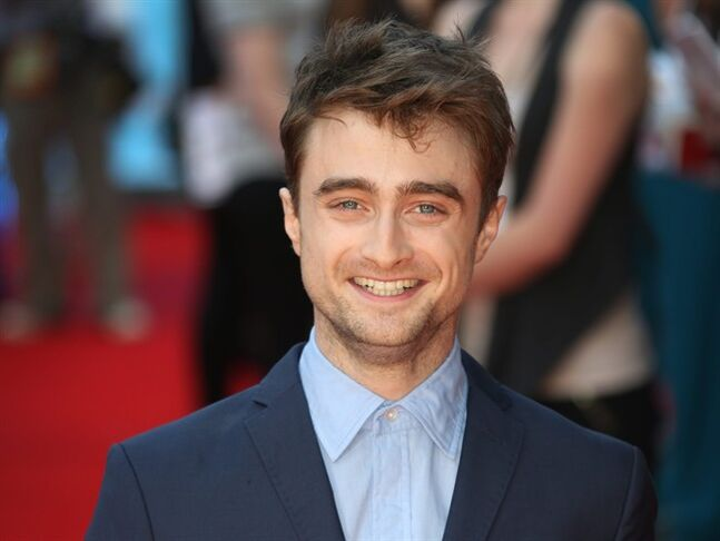 "FILE - In this file photo taken Tuesday, Aug. 12, 2014, British actor Daniel Radcliffe reacts, as he arrives on the red carpet for the UK premiere of What If, at the Odeon West End in central London. aniel Radcliffe says he finds the concept of celebrity and the level of interest in the trivia of actors' lives ""weird."" While promoting his first romantic comedy _ ""What If,"" directed by Michael Dowse _the 25-year-old British star was keen to keep the conversation away from his own love life. Radcliffe is rumored to be dating his ""Kill your Darlings"" co-star Erin Drake. (Photo by Joel Ryan/Invision/AP)"