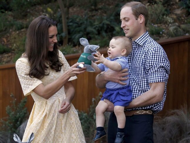 FILE - This is a Sunday, April 20, 2014 file photo of Britain's Kate, the Duchess of Cambridge, and her husband Prince William as they give their son Prince George a stuffed toy of Australian animal called a Bilby, which has been named after the young prince, during a visit to Sydney's Taronga Zoo, Australia. Prince George turns 1 on Tuesday. While he may be too young to appreciate it, the milestone is causing a nationwide frenzy. Editorial writers call him a symbol of hope, newspaper headlines hail him as
