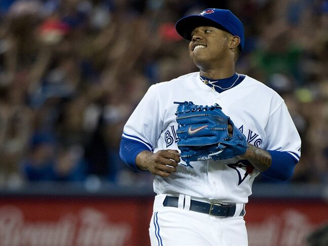 Toronto Blue Jays starting pitcher Marcus Stroman reacts after getting out of the eighth inning against the New York Yankees during AL baseball action in Toronto on Monday, June 23, 2014. THE CANADIAN PRESS/Nathan Denette