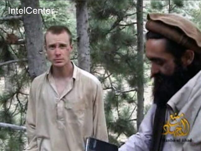 FILE - This image made from video released by the Taliban and obtained by IntelCenter on Dec. 8, 2010, shows a man believed to be Bowe Bergdahl at left. Bergdahl, a U.S. Army soldier, went missing from his outpost in Afghanistan in June 2009 and was released from Taliban captivity on May 31, 2014 in exchange for five enemy combatants held in the U.S. prison in Guantanamo Bay, Cuba. (AP Photo/IntelCenter, File) MANDATORY CREDIT: INTELCENTER; NO SALES; EDS NOTE: