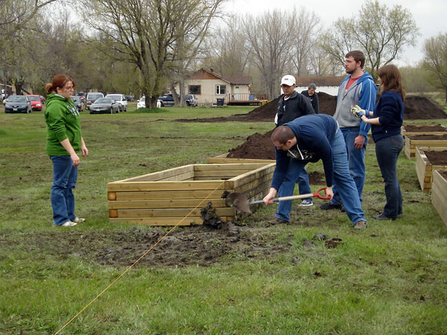 Members of SIFE dig in to set up the garden beds in their community-based garden initiative, which gives families the opportunity to grow and sell their own fresh produce to help generate extra income.