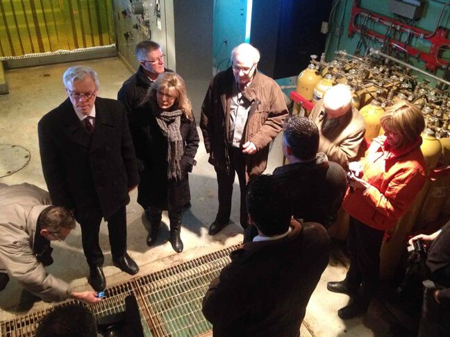 Premier Greg Selinger (far left), with MP Shelly Glover (left) tours the inside of the Red River Floodway facilities Tuesday.