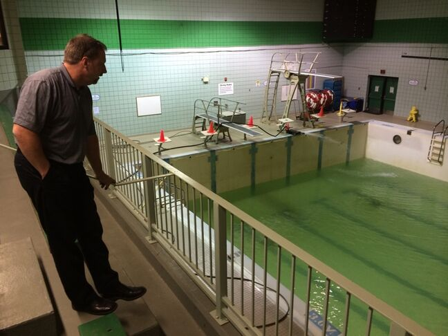 Half empty? Or half full? Jeff Elliott, facility manager at Sportsplex, looks on as the pool is refilled after a week-long repair earlier this winter.