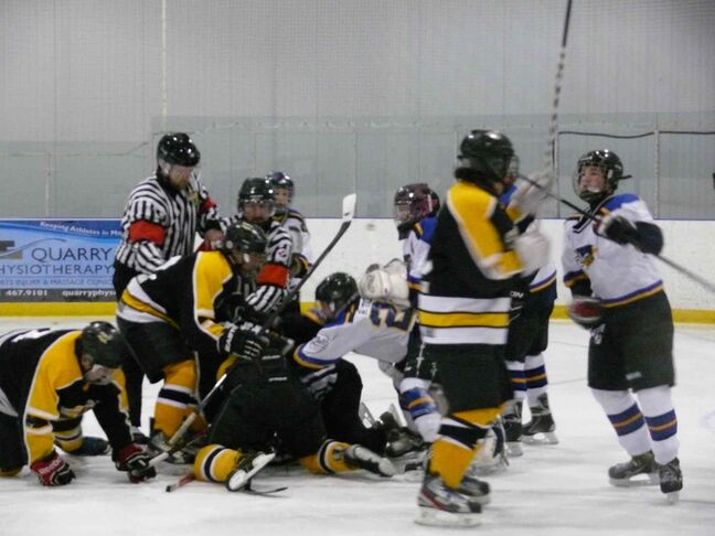 A male linesman was kicked and punched by players while he was lying on the ice during an Interlake bantam boys minor hockey playoff game in Stonewall on Sunday afternoon.