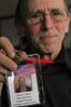 David J. Straub of Willow, Alaska, holds up his work badge for his marijuana cultivation business during a break at the Alaska Marijuana Control Board meeting in Anchorage, Alaska, on Wednesday, April 27, 2016. Alaska will be the first state in the nation to allow the onsite consumption of marijuana at some retails stores, and the board was considering regulations for that. (AP Photo/Mark Thiessen)