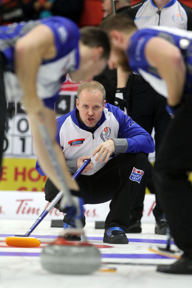 Skip Mark Nichols of Team Gushue guides in a rock against Brad Jacob's foursome at the Home Hardware Canada Cup of Curling on Wednesday. (Tim Smith/Brandon Sun)