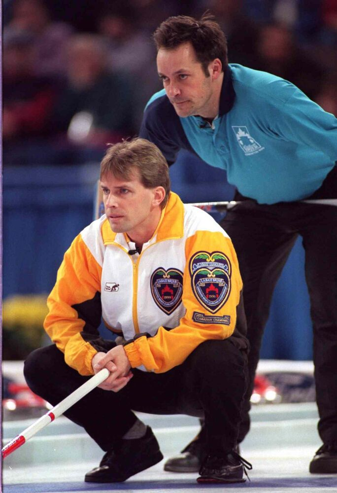 Quebec Skip Guy Hemmings looks over Manitoba Skip Jeff Stoughton's shoulder during the final of the 1999 Brier in Edmonton. (CHRISTINE VANZELLA / The Canadian Press files)
