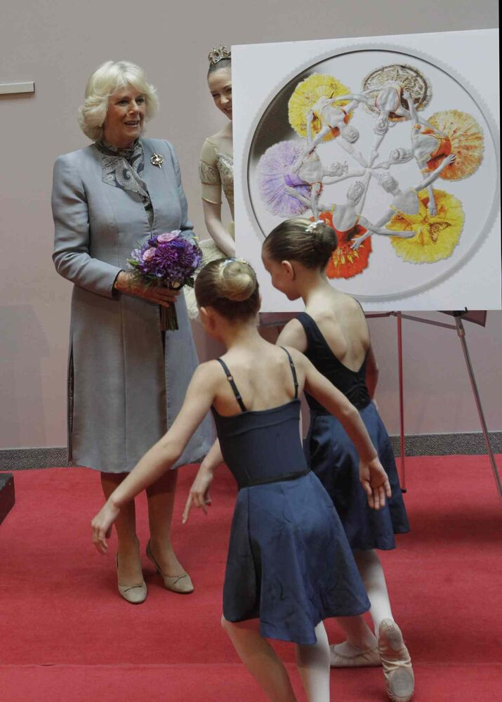 Camilla, Duchess of Cornwall received flowers from young dancers Ava Skromeda, left and Lynea Turner after she helped to unveil the new silver collector coin to commemorate the 75th anniversary of Canada's Royal Winnipeg Ballet. Wednesday morning.  (Wayne Glowacki / Winnipeg Free Press)