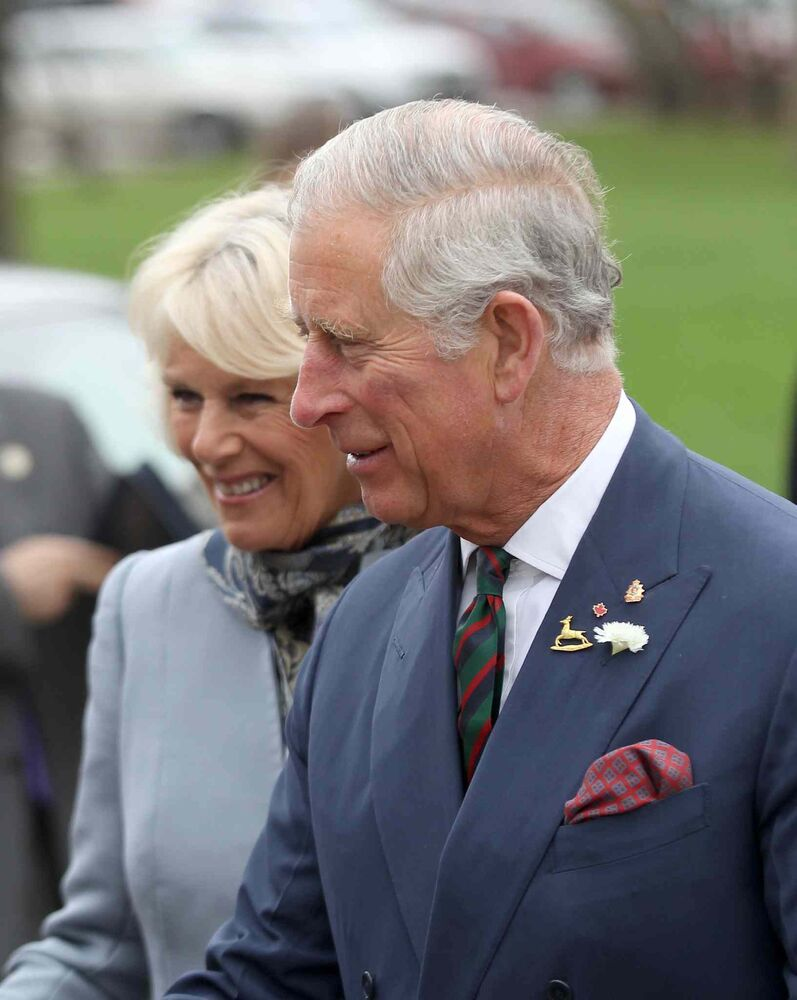 Prince Charles and the Duchess of Cornwall arrive at the Assiniboine Park Pavilion Gallery. (JOE BRYKSA / WINNIPEG FREE PRESS)