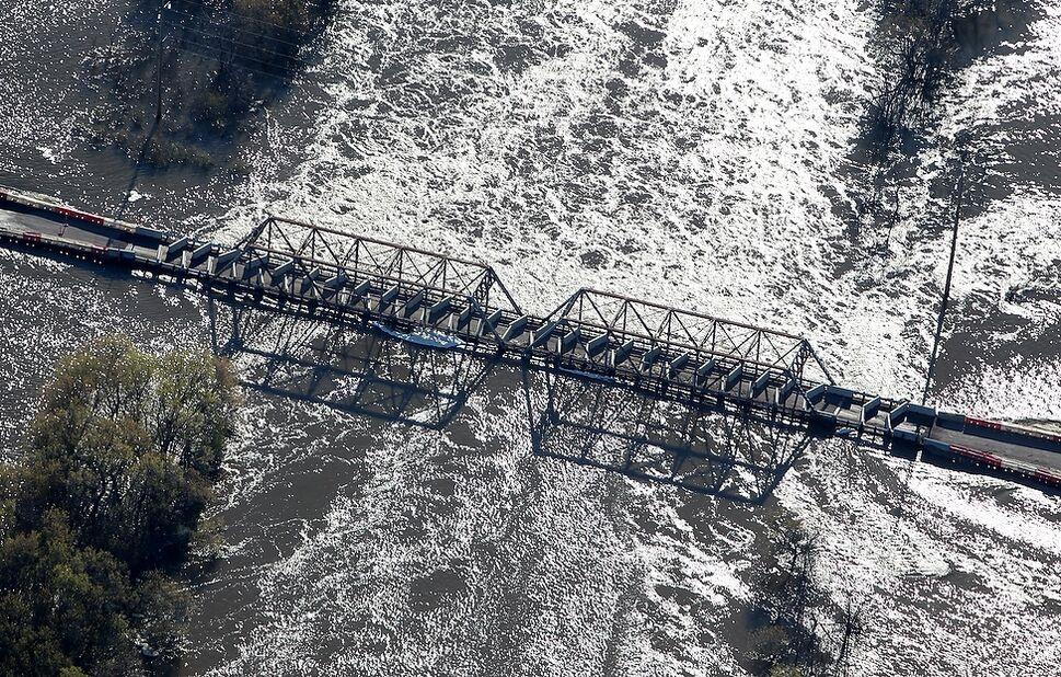 The Highway 250 bridge over the Assiniboine River north of Alexander barely sits above water on Monday morning.