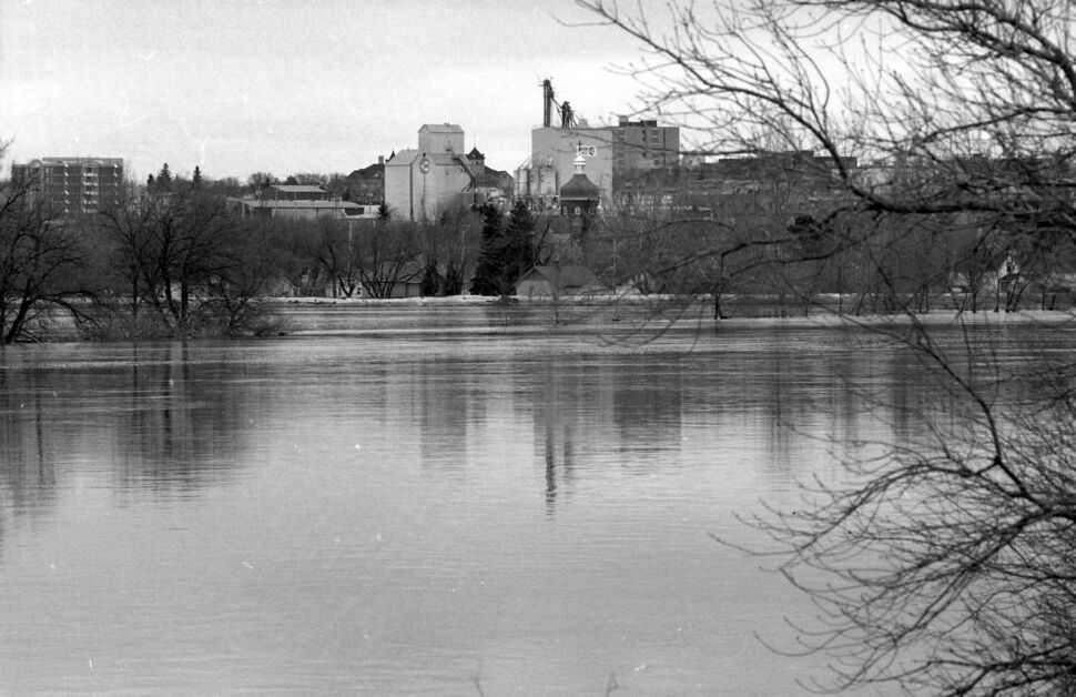 Looking south or south-east over the Assiniboine River, which has spilled its banks, towards central Brandon. (Dirk Aberson / Brandon Sun archives, April 28, 1995)