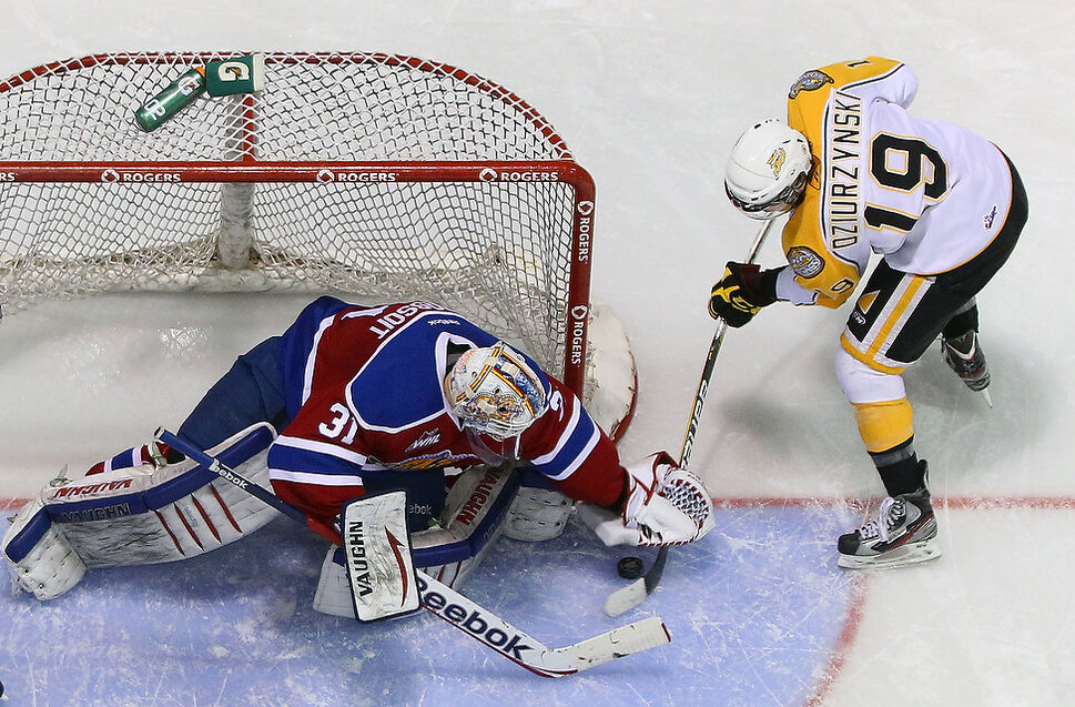 Darian Dziurzynski #19 of the Brandon Wheat Kings tries to stuff the puck past goalie Laurent Brossoit #31 of the Edmonton Oil Kings during the second period of game four. (Tim Smith)