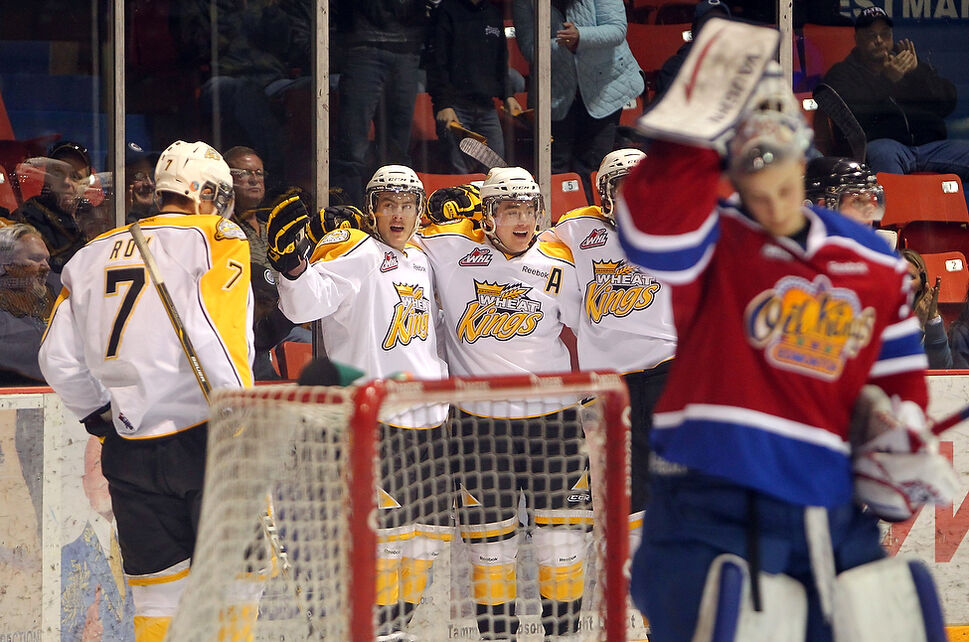 Ryan Pulock #2 (second from left) of the Brandon Wheat Kings celebrates a goal with teammates during the first period of game three of the Wheaties WHL playoff series against the Edmonton Oil Kings. The Oil Kings won game three by a score of 5-1.  (Tim Smith/Brandon Sun)